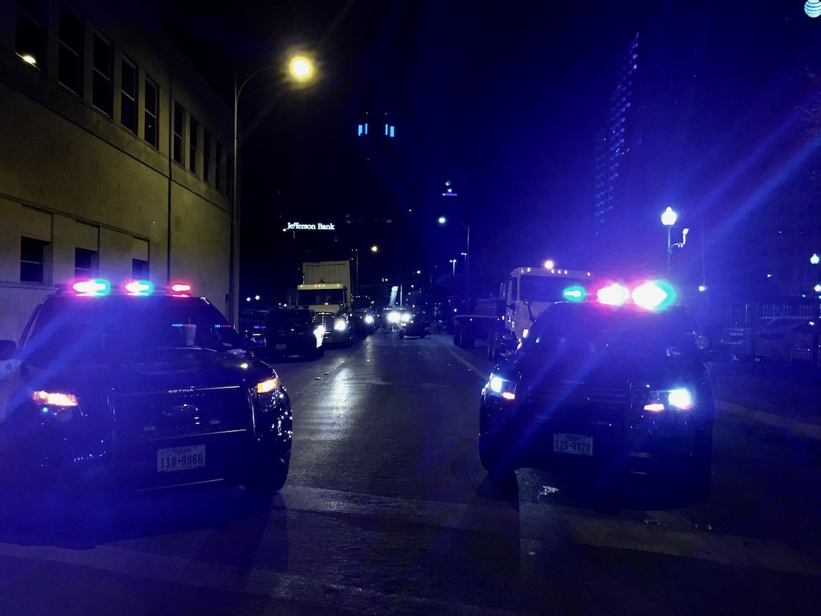 Police vehicles block off traffic on streets surrounding Travis Park and the Confederate monument.