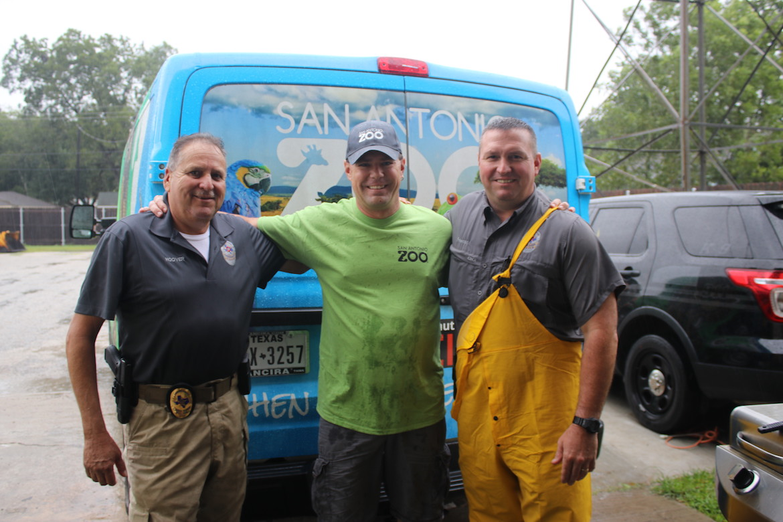 Craig Pelke (center) of San Antonio hands off humanitarian supplies to Eagle Lake Sheriff's Department representatives.