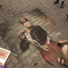 "Pat Duke creates a chalk rendition of Édouard Manet's ""The Fifer"" at Chalk It Up."