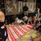 A chalk rendition of Campbell's Soup Cans is drawn on the sidewalk at Chalk It Up.