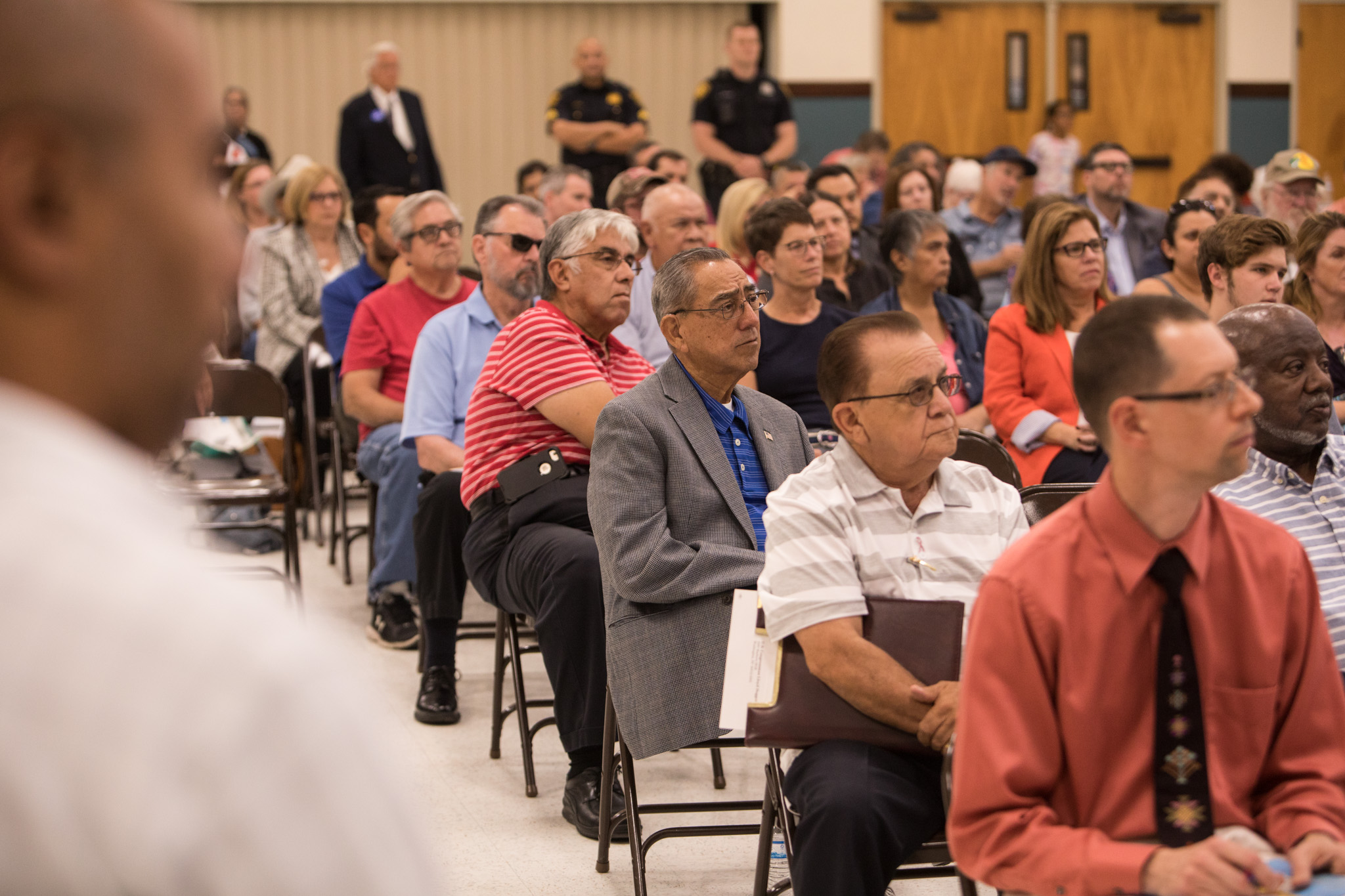 A large group of community members of Government Hill gather for a town hall meeting at St. Patrick Catholic Church.