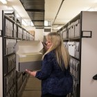 Texas A&M University-San Antonio Archives and Special Collections Manager Leslie Stapleton demonstrates how the archives are filed in the vault.