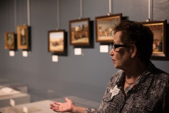 Daughters of the Republic of Texas Library Collection Committee Chairman Susan Riedesel walks through the Presidio Gallery in the Bexar County Archives Building.