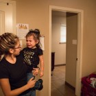 Briana Zapata, 17, comforts her daughter Daniella, 1, in their bedroom at the SJRC Texas Pregnant Parenting Teen Program.