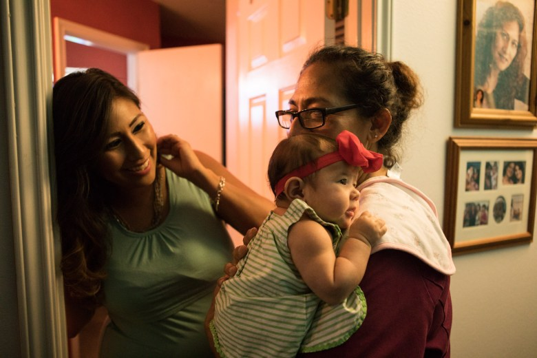(From left) Angela Mercado laughs with her daughter Zoryan Miko Mercado, 9 weeks, and her mother Dolores Gomez.