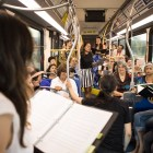 """The From Those Who Follow the Echoes choir performs """"VIA VIVA Cultural Adventure"""" aboard the VIA VIVA Culture Bus."""