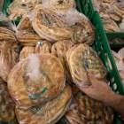 Ali Baba International Food Market Owner Ashraf Nahil picks up one of the unique varieties of bread the market offers.