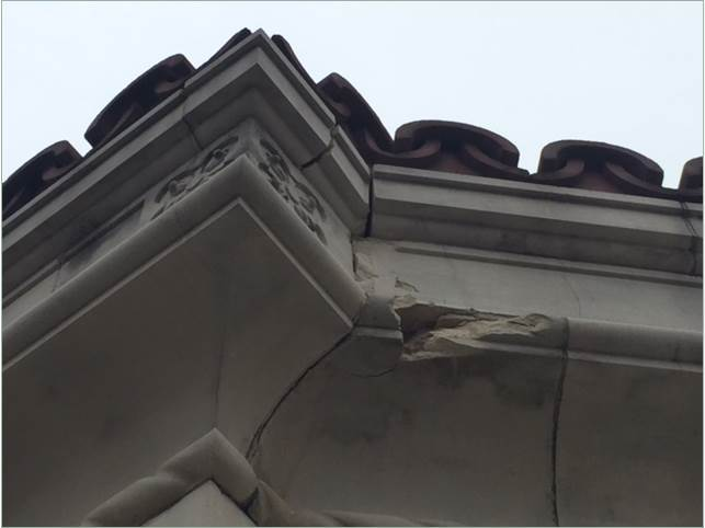 A portion of cracked facade at City Hall.
