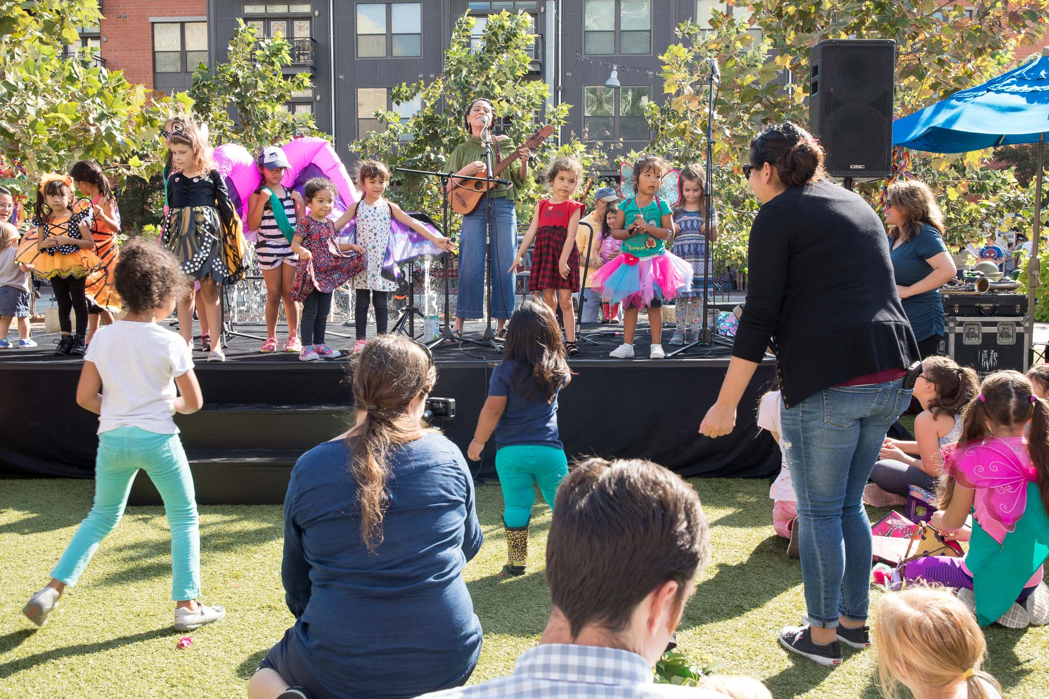 Azul Barrientos performs as she is accompanied on stage by children dressed as butterflies.