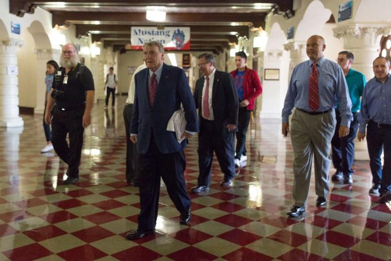 Longtime journalist and Jefferson High alumnus Jim Lehrer tours the hallways of his old school.