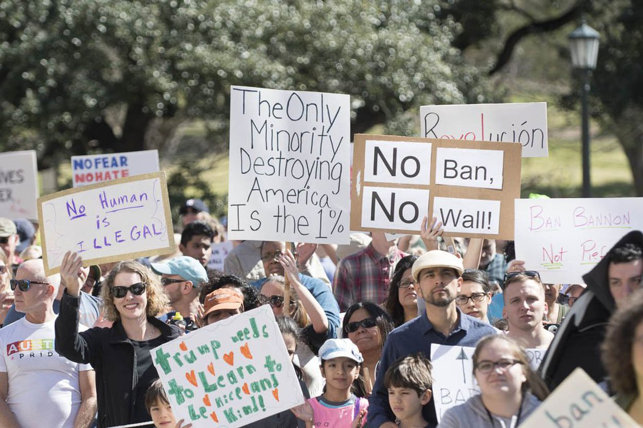 Protesters at the Texas Capitol on Feb. 25, 2017 carry a wide variety of signs denouncing Donald Trump's immigration policy and the divisiveness sparked by recent immigration raids in Texas.