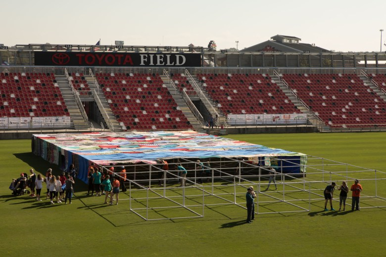 Autism Uncovered volunteers construct the world's largest blanket fort for autism awareness at Toyota Field.