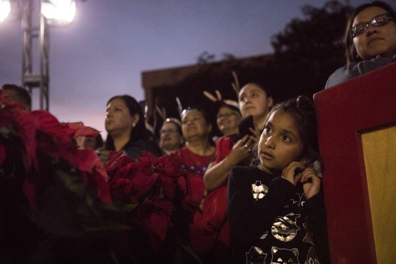 Elena Chapa, 6, listens to the music before the 33rd Annual H-E-B Christmas Tree Lighting celebration in Travis Park.
