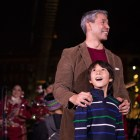Jonah Nirenberg gasps in delight next to his father Mayor Ron Nirenberg at the 33rd Annual H-E-B Christmas Tree Lighting celebration in Travis Park.