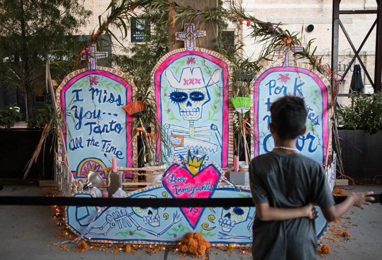 "Cruz Ortiz displays ""Altar in Honor of All Immigrant Workers"" for Día de los Muertos at the Pearl."