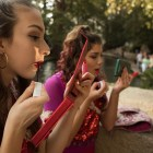 Alamotion Dance Troupe dancers put the finishing touches on their makeup at Diwali San Antonio: Festival of Lights.