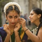 (From right) Santhamma Tomichan helps her daughter Ittiyanam Tomichan, 13, fix her earrings before her performance at Diwali San Antonio: Festival of Lights.
