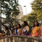 Dancers line up on a bridge overlooking Arneson River Theatre to view the performances at Diwali San Antonio: Festival of Lights.