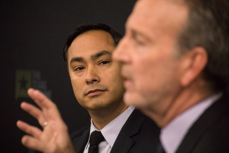 (From left) U.S. Rep Joaquín Castro (D-Texas) listens to former U.S. Ambassador to Mexico Antonio Garza respond to a question at a symposium on immigration at University of Texas at San Antonio – Downtown Campus.