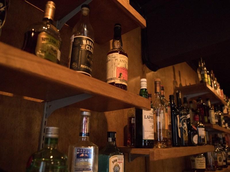 Bottles of liquor line the shelves of The Modernist.