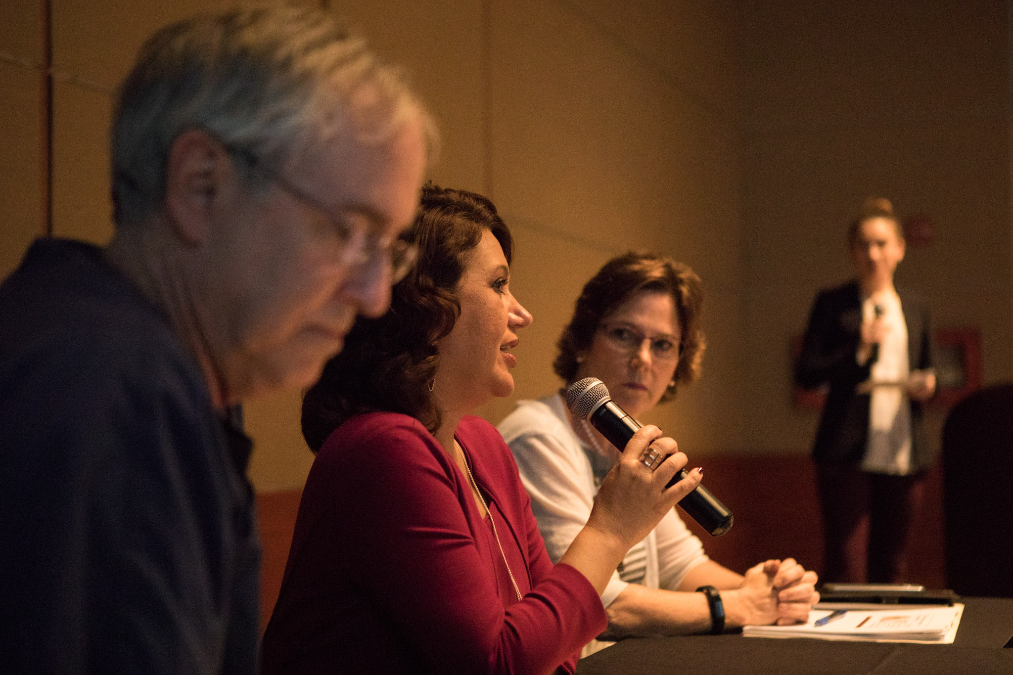 (From left) American Heart Association Board President Landon Wellford, Tricare Division at Humana Chief Medical Officer Sandra Delgado, and San Antonio Metropolitan Health District Director Colleen Bridger partake in a panel discussion at the Tobacco 21 Town Hall Meeting at La Orilla Del Rio Ballroom.