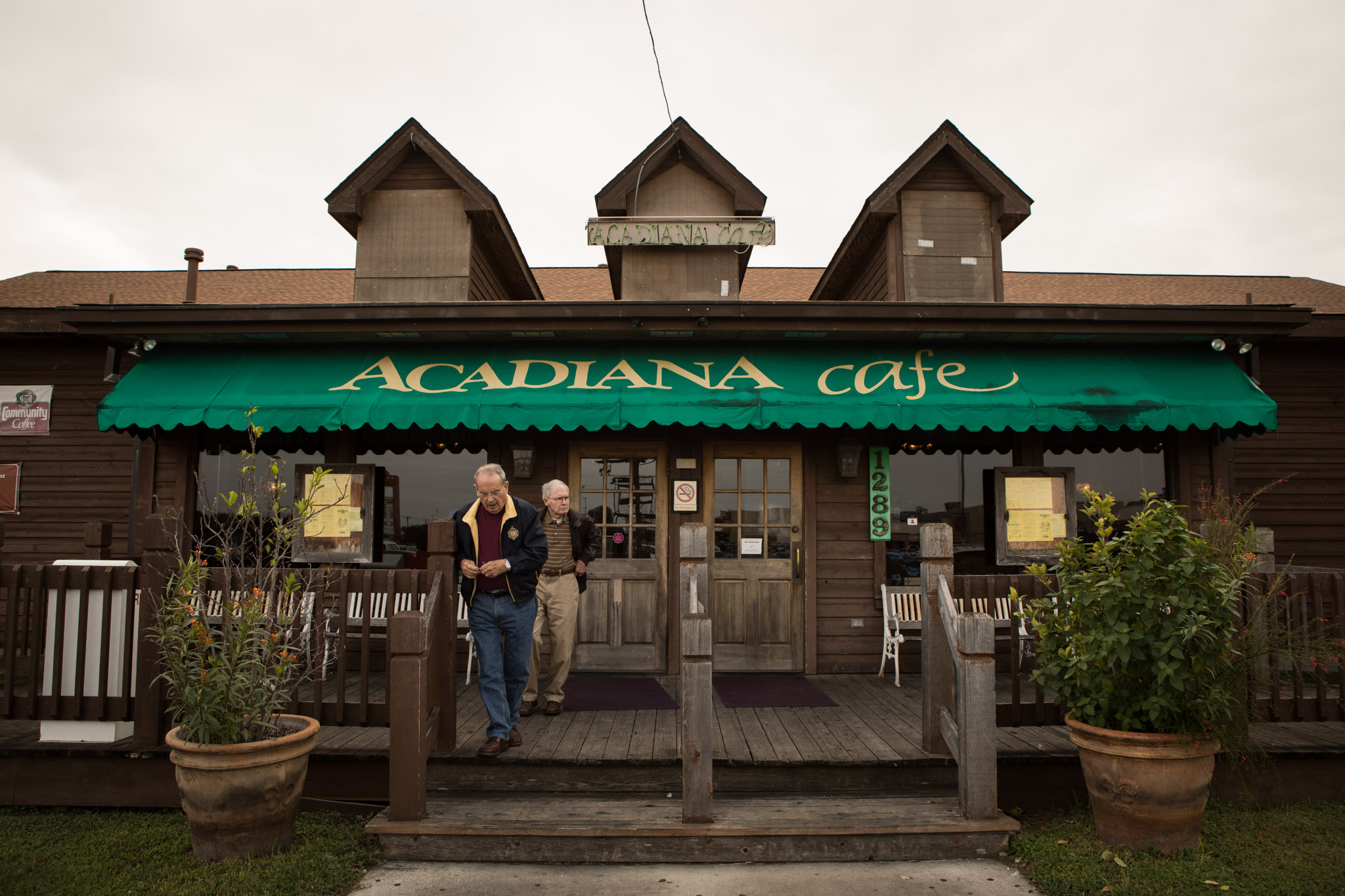 Two men exit Acadiana Café during lunch hour on Veterans Day.