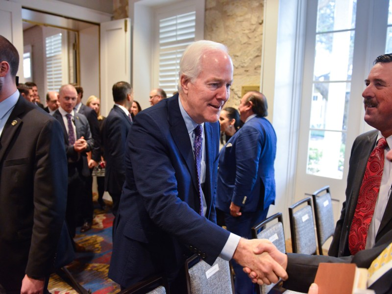 U.S. Sen. John Cornyn (R-Texas) greets attendee's prior to a hearing on the modernization of the North American Free Trade Agreement.