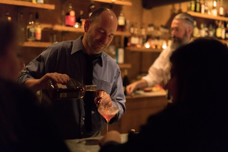 Olaf Harmel concocts the Modernist Cup in front of patrons at his bar, The Modernist.