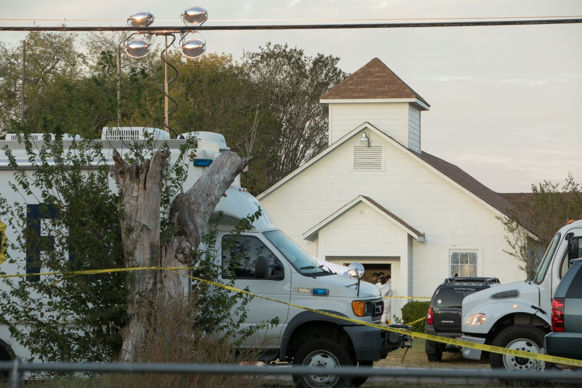 Investigators examine the First Baptist Church in Sutherland Springs, where a shooting left 26 people dead.
