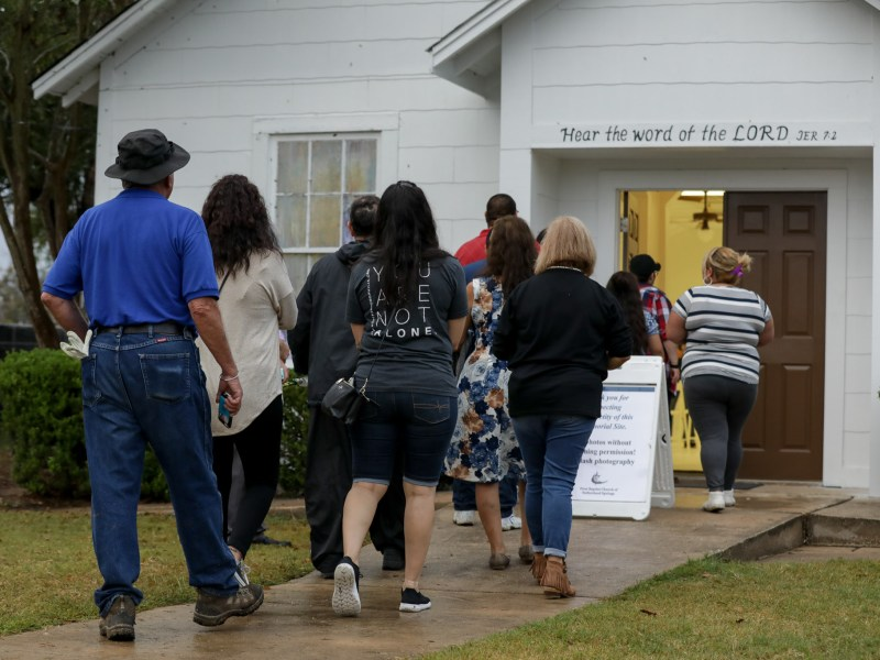 Community members arrive to the church for the first time since the deadly shooting one week prior.