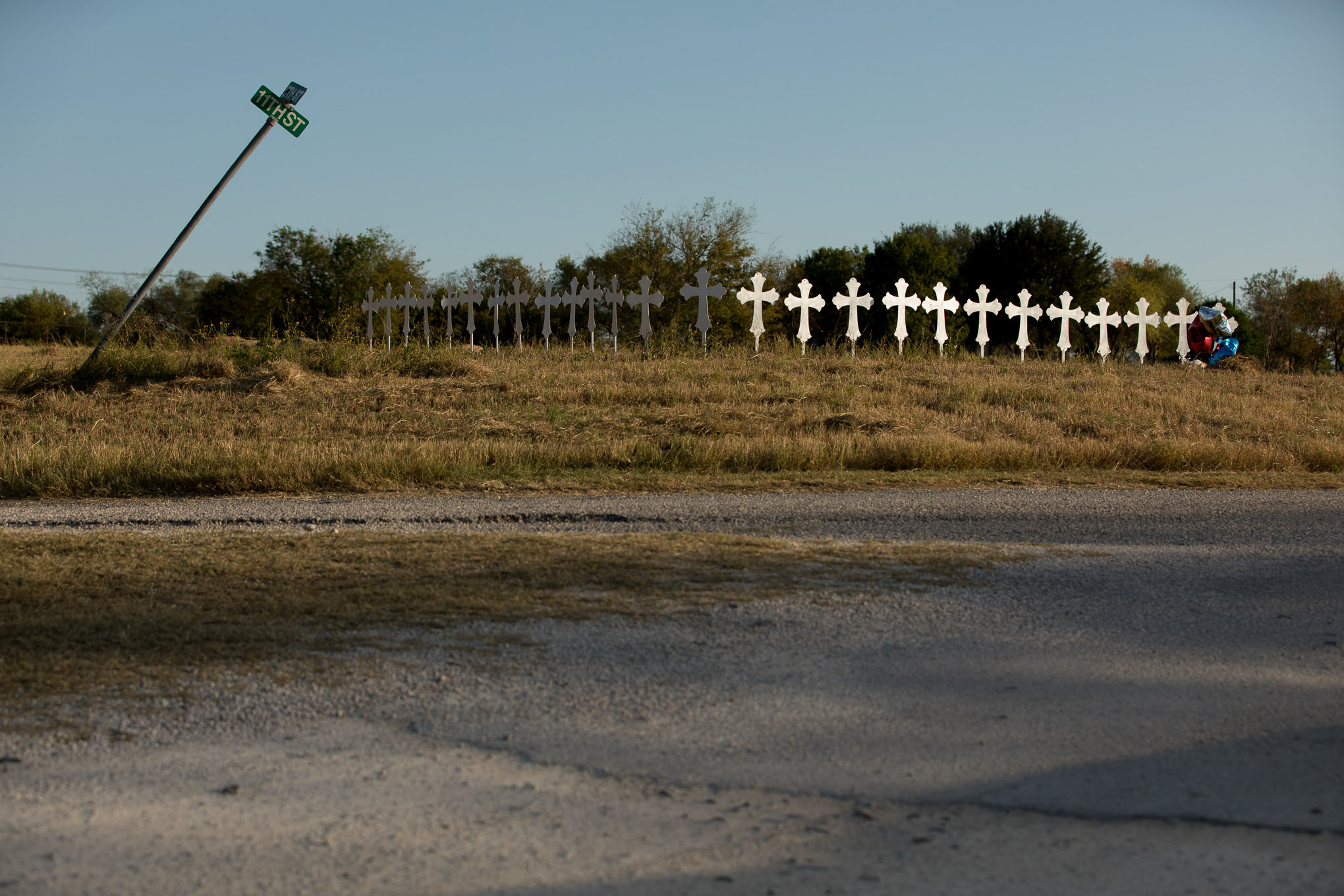 26 white crosses stand in a field in Sutherland Springs memorializing the 26 who died in the church massacre on Sunday.