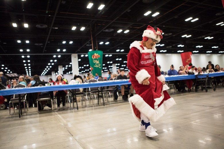 Margaret Arriaga, 82, dances to mariachi music at the 25th annual H?E?B Feast of Sharing holiday dinner.
