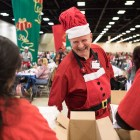 Jerry Reed greets H-E-B partners at the 25th annual H?E?B Feast of Sharing holiday dinner.