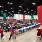 Thousands gather to volunteer and eat at the 25th annual H?E?B Feast of Sharing holiday dinner.