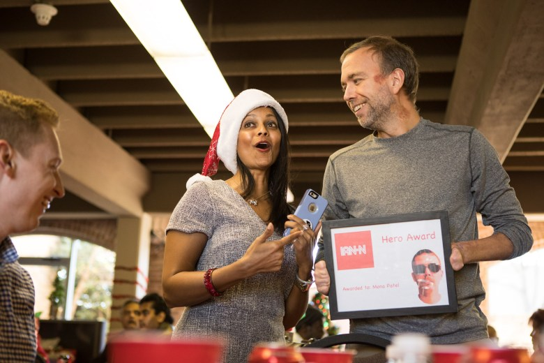 """Ian Warshak (right) presents San Antonio Amputee Foundation Founder and Executive Director Mona Patel with a comedic hero award, exchanging """"CNN"""" with """"IAN-N."""""""