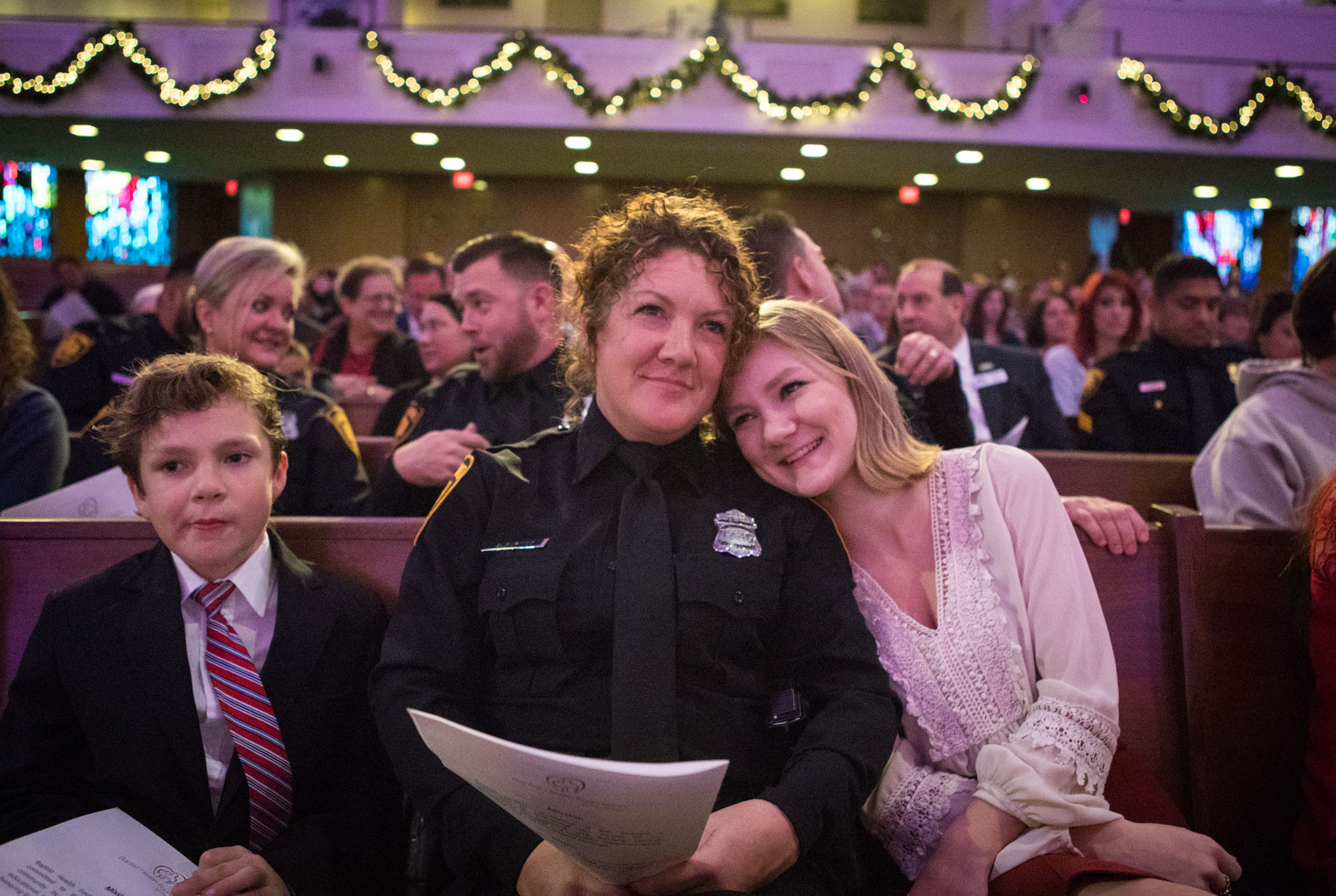 San Antonio Police Department's Mental Health Detail Officer Shannon Purkiss sits with her children Will, 10, (left) and Hannah before the Baptist Health Foundation Grant Awards Ceremony.