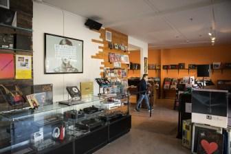 Southtown Vinyl Sales Associate Paul 'DJ Chacho' Perez helps organize the shop.