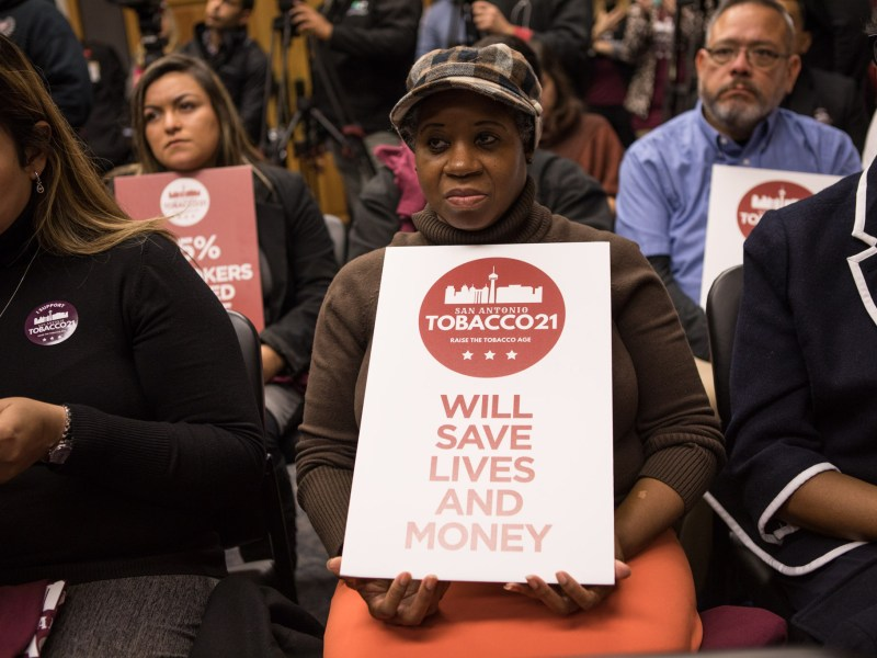 Amy Alston holds a sign supporting Tobacco 21.