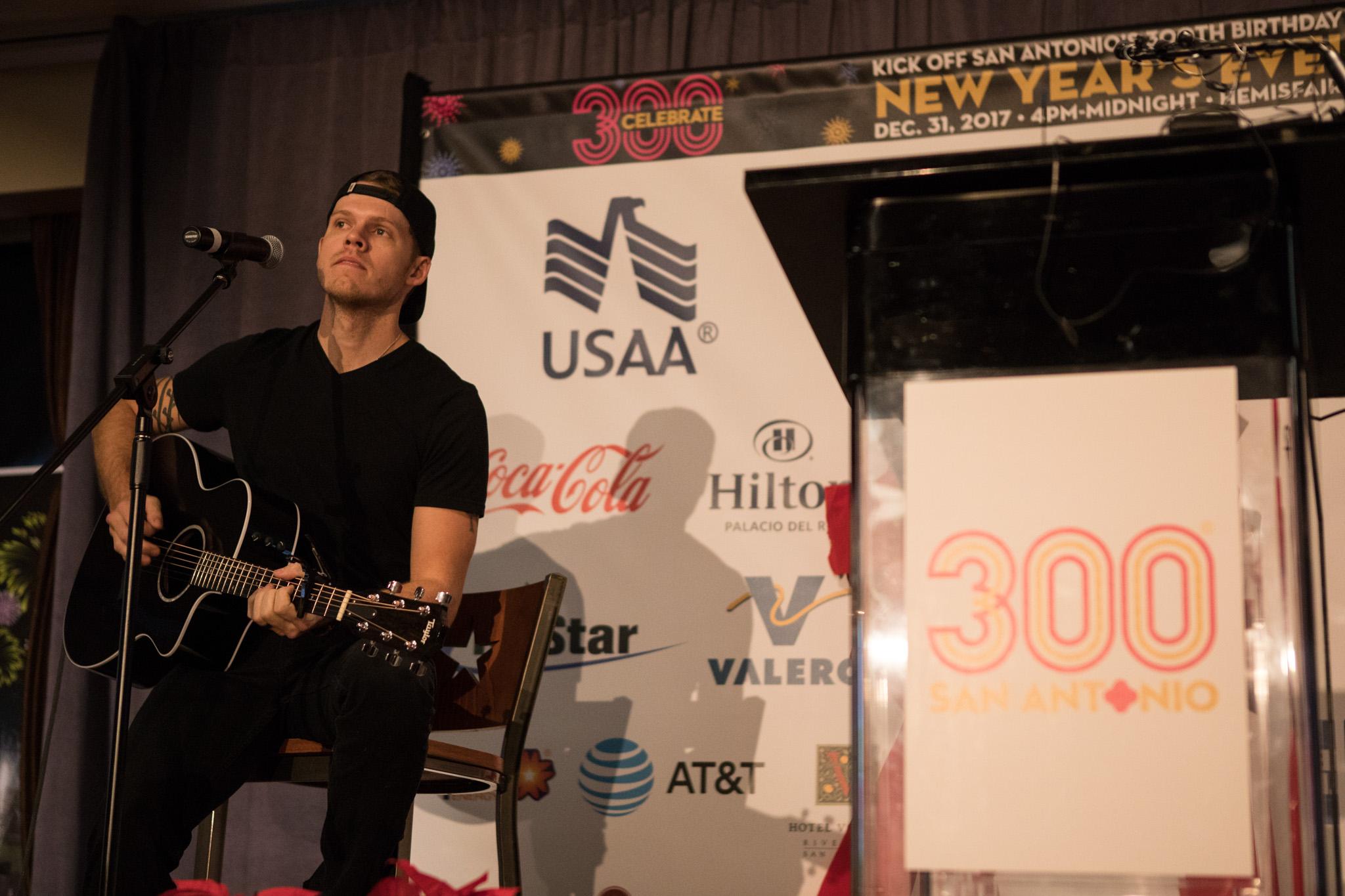 Musician Sam Riggs performs at a Tricentennial announcement.