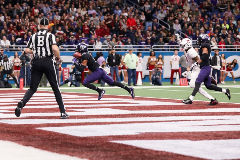 Nick Orr (center) intercepts the ball in the TCU end zone.