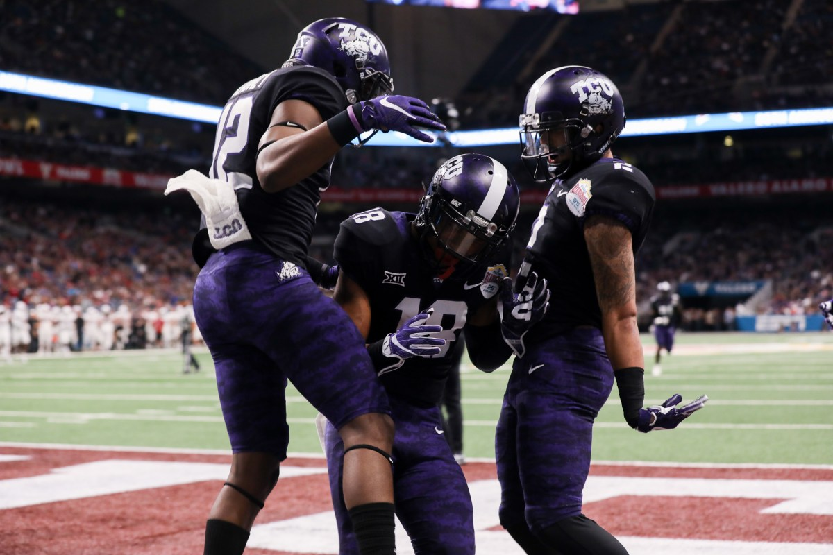 TCU players celebrate after safety Nick Orr (center) intercepted the ball in the TCU end zone.