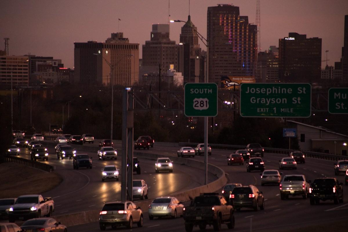 Cars travel along U.S. Highway 281 in San Antonio at dusk.