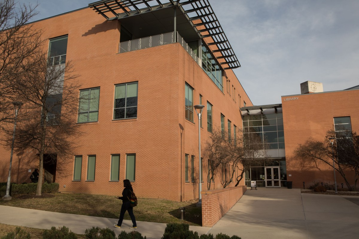 A student passes by the Northeast Lakeview College library.