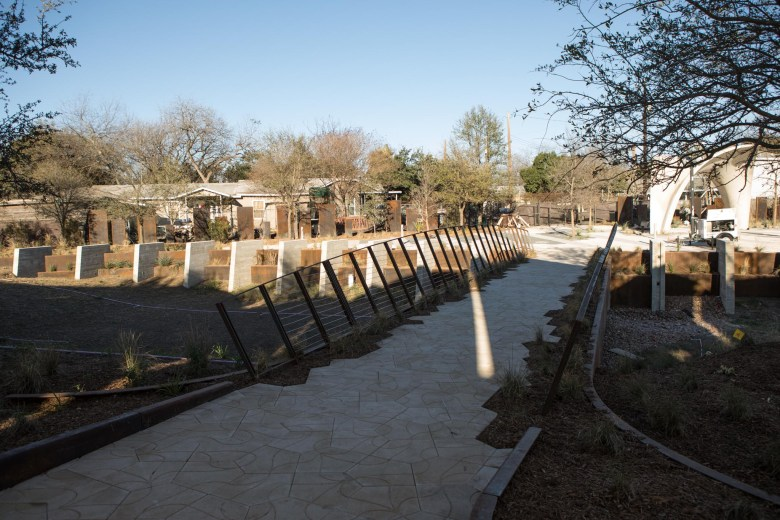 A bridge crosses the land in which an underground rain water harvesting cistern is buried.