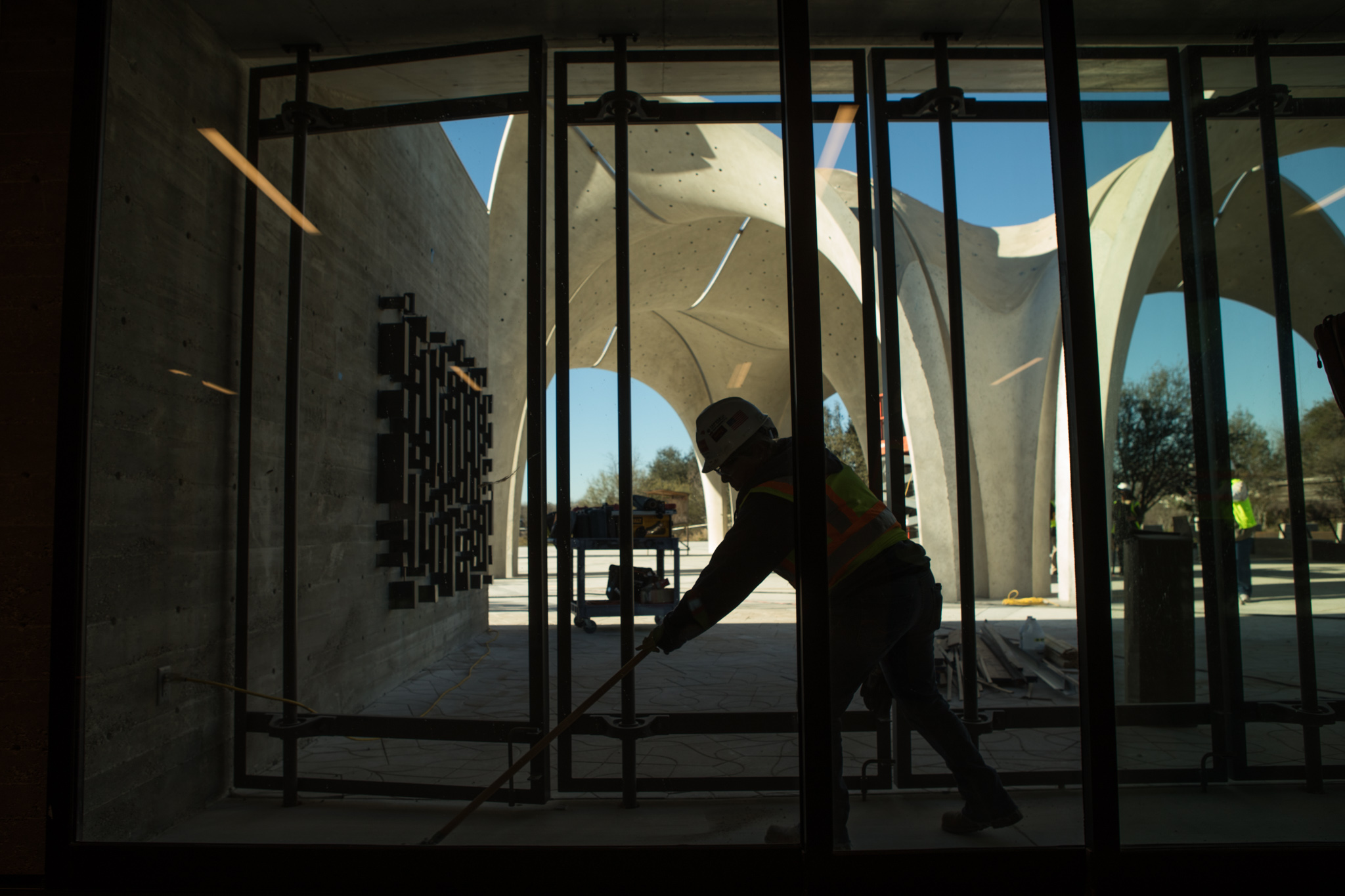 A man sweeps the inside of the Estela Avery Education Center before the opening of Confluence Park.
