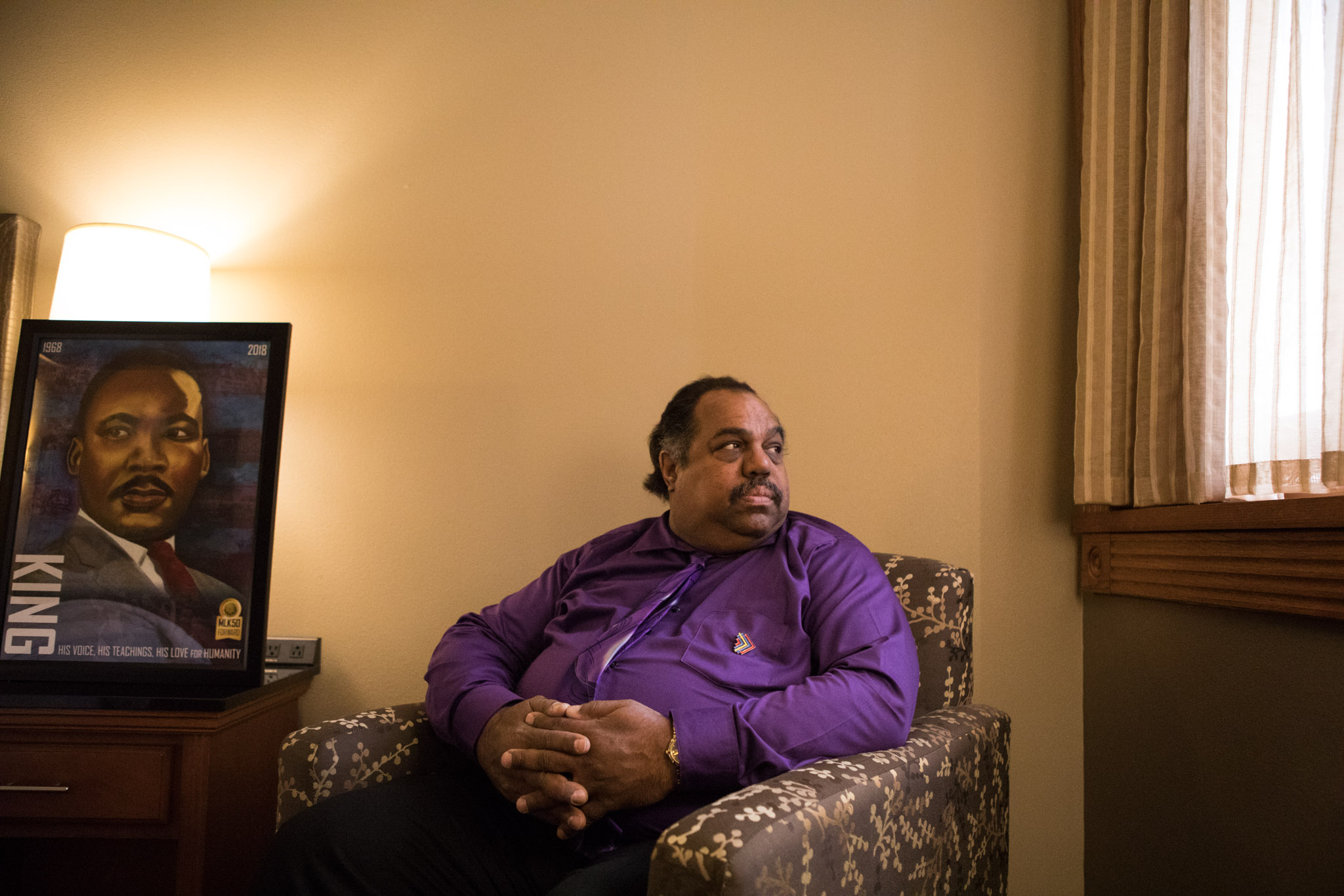Daryl Davis sits next to his MLK, Jr. Commission poster awarded to him by DreamVoice and the MLK, Jr. Commission during DreamWeek.