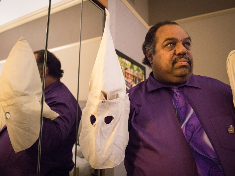 Daryl Davis holds a Ku Klux Klan hood given to him by a previous Klan member.