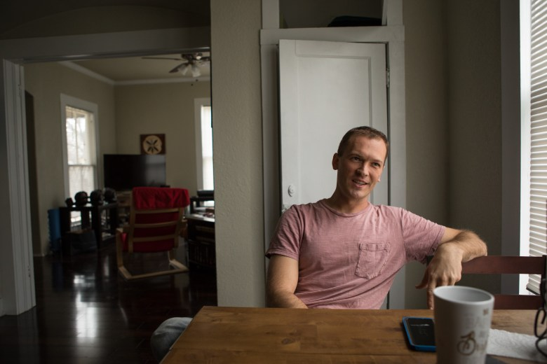 Giles Gonnsen sits at the dining table in his Denver Heights home.