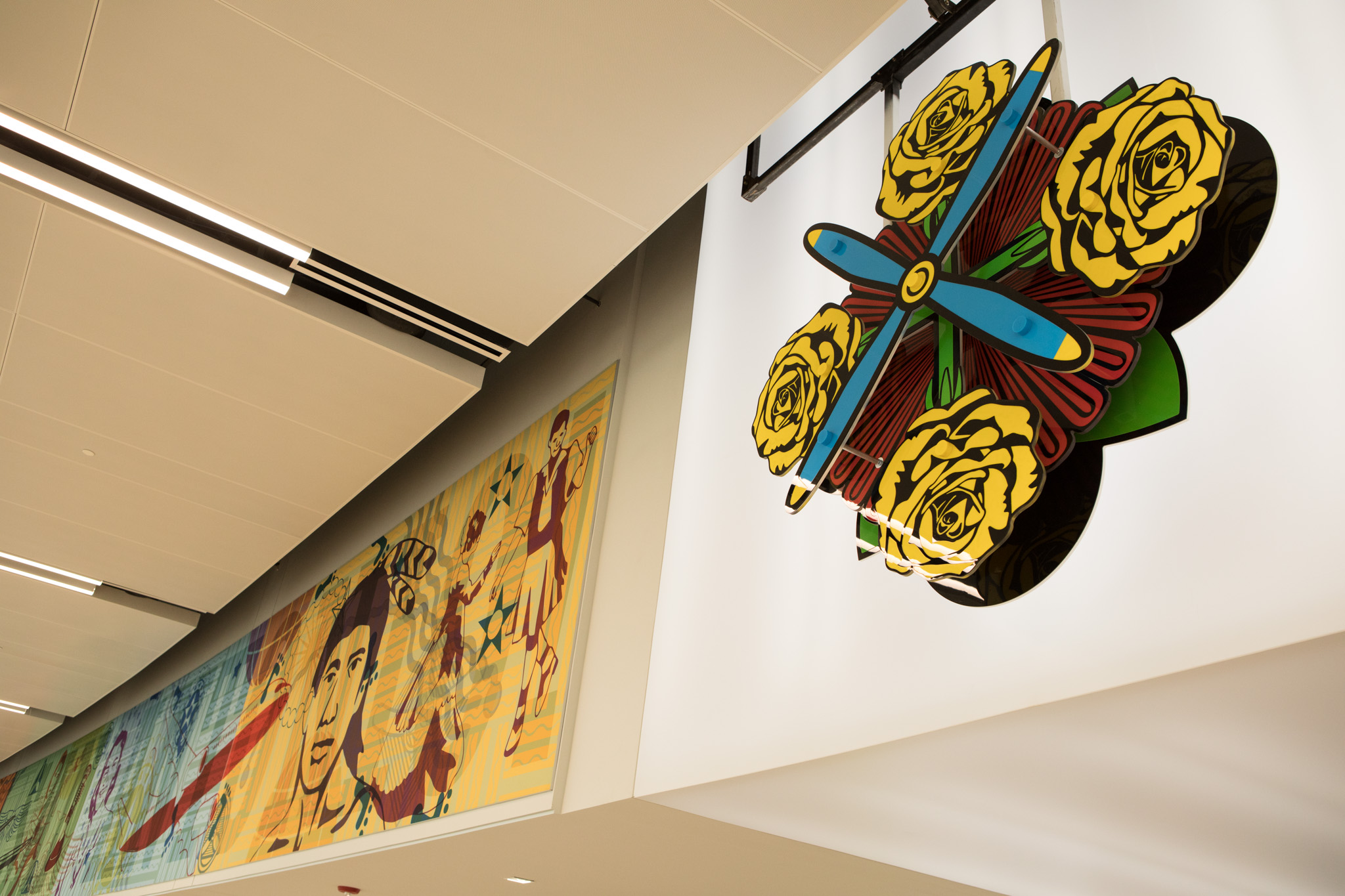 The first element of the Dos Mestizx mural visible from the sky bridge entrance is the three-dimensional Ventana Rosada, or Rose Window.
