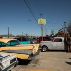 The River City Classics Car Club lines up their vehicles along Enrique M. Barrera Parkway, formerly known as Old Highway 90.